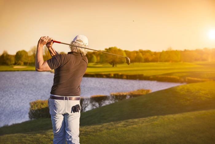 senior golfer golfing