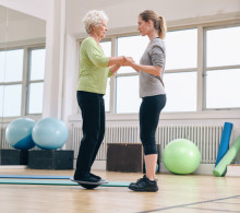 Senior woman with trainer