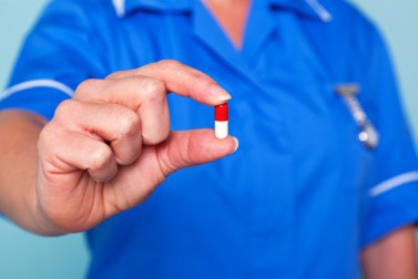 Nurse offers ibuprofen