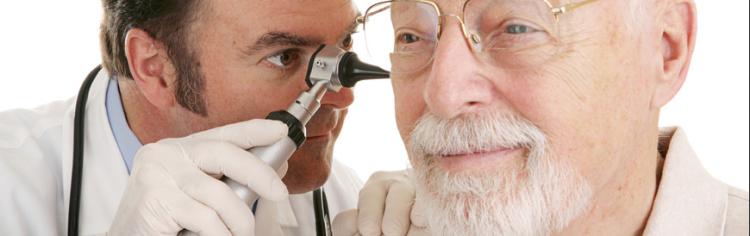 doctor inspecting older gentleman's ears