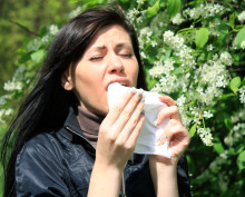 woman with allergies sneezing