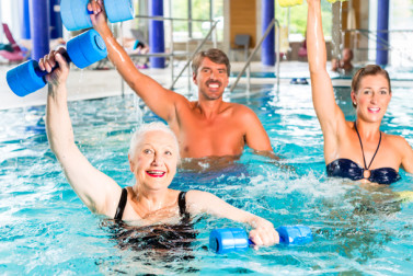 Seniors in aerobic swimming class.
