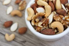 a bowl of nuts with health benefits
