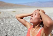 Woman in the sun risking dehydration