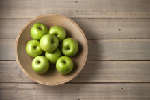 a bowl of organic apples