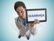 Doctor holding up a sign that says diarrhea