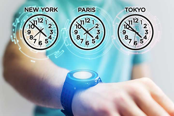 Medical person wearing smart watch displaying different time zones