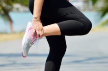 woman experiencing muscle cramps