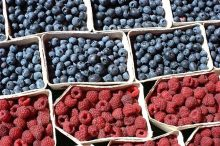 baskets of blueberries and raspberries that contain health benefits