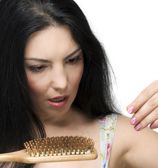 Woman suffering from hair loss due to high blood sugar