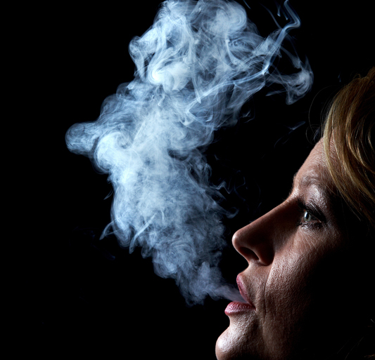 mouth cancer -- woman smoking cigarette